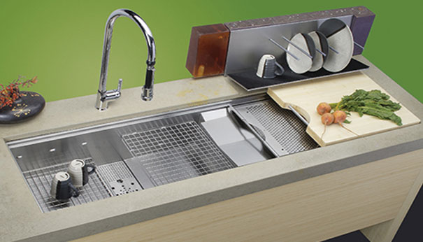 Stainless steel sink with colander, cutting board, dish rack, and integrated strainer