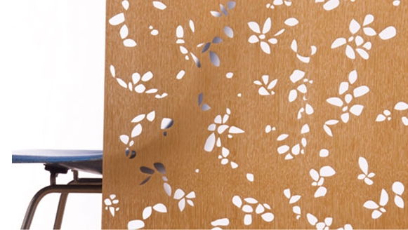 Translucent panel of laser cut wood veneer
