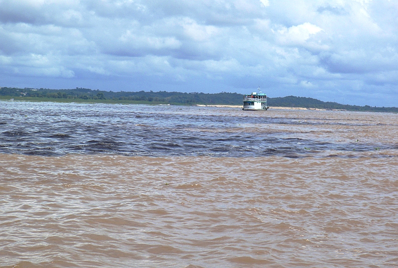 Two rivers of different colors flow side by side at Manaus, a phenomenon called Meeting of the Waters.