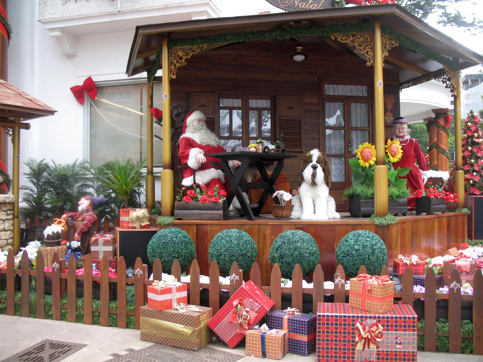 X'mas Vignette with Mr. and Mrs. Claus, their Saint Bernard, and a pile of gifts.