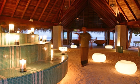 Resort showing use of illuminated seating and lamps in open air structure