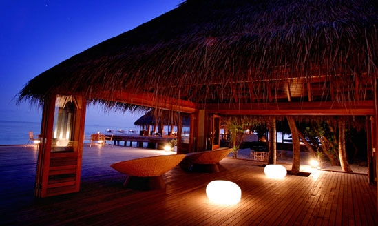 Illuminated boulder-like seats in the palapa of a resort